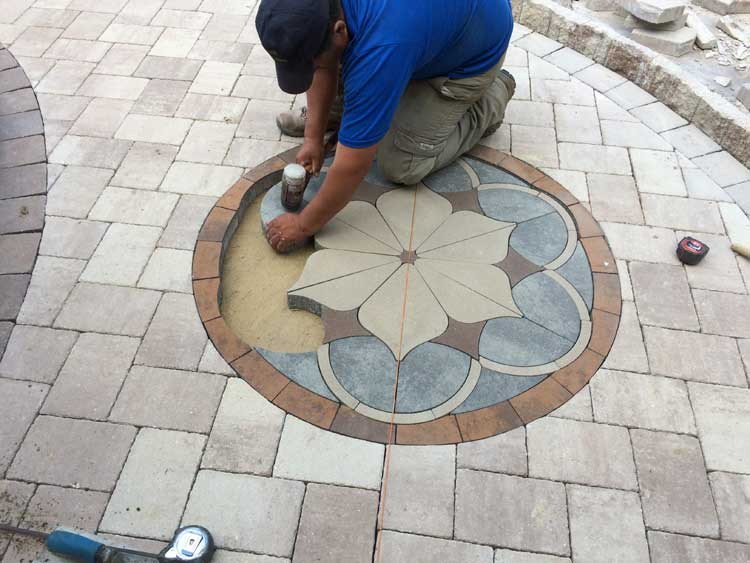 Installing paver kit pieces